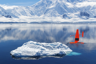 Image of a Saildrone going past an iceberg